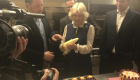 Jamie Oliver teaches the Duchess of Cornwall how to ice cakes